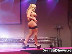 Blonde girl dances and spreads her legs