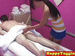 Asian masseuse tugging client in front of spycam