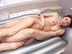 Asian babe Riri Fuji gets her body oiled up in massage sex