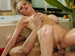 Blonde MILF's big boobs bounce while she rides a hard prick