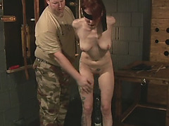 Redhead babe gets tied up and whipped