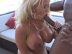 Busty oiled cougar Alura Jenson strokes white dick and gets fucked
