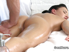 Relaxed brunette gets masseurs hard cock till orgasm