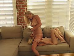 Playful beach babes Tara Morgan and Mandy Armani try lesbian sex