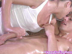 Classy masseuse jerking her client