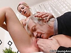 Nelya gets her breasts licked and sucked by her older man and enjoys his touch.