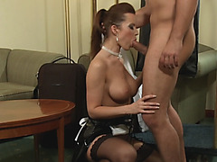 Cindy Dollar wears black stockings while sucking dick and getting fucked hard