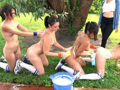 Group of poor rushes strip down and washing each others asses