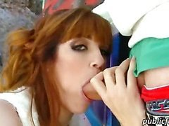 Redhead chick shaking her booty and pussy ripped in public