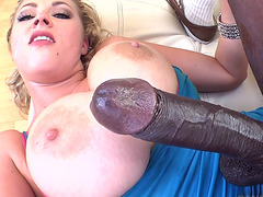 Big titted bombshell takes a huge cock up her wet pussy!