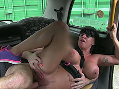 Busty amateur gets turned on and gets fucked inside the taxi
