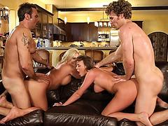 Two luscious pornstars enjoying foursome