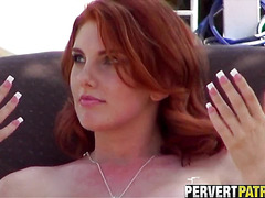 Amazing redhead tanning by the pool
