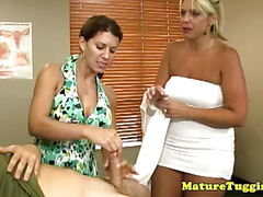 Mature cougar milfs wank cock together