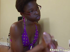 Dark black ebony skank stroking dick