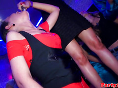 European party babes suck cock in middle of club