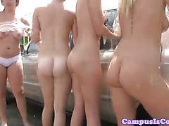 College teens lick box at the car wash