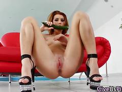 Horny slut fucks cucumber