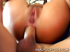Anal sex with sexy brunette on the couch.
