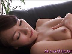 Little asian milf rubbing her cunt