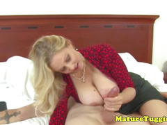 Glam cougar tugging a younger mans cock