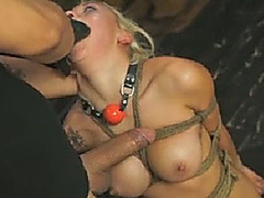 Gorgeous blonde slave enjoys deep throat and doggystyle fuck