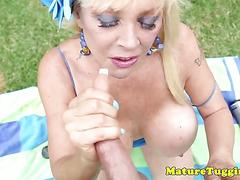 Massive tit milf outdoors jerking on cock