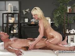 Big tits blonde wanks masseurs cock and fucks him