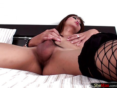 Exotic femboy with decent tits tugs her hard hairy shaft