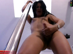Slim tgirl with natural tits shows off her hot elegant body