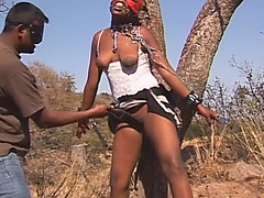 Masked black chick gets tied to tree and perkyd with sex toys