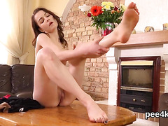 Breathtaking chick is peeing and fingering bald vagina
