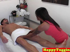 Inked asian hanjob masseuse gets fingered