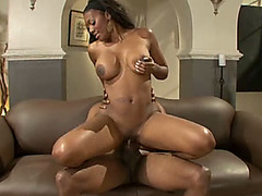 Overdeveloped black babe with huge bouncing tits rides black dick