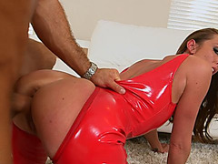 Aria Xcite wears red latex outfit while having passionate sex