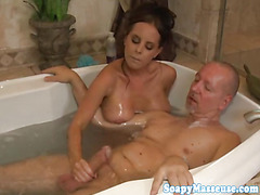Busty masseuse bodysliding and cocksucking