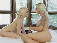 Two hot looking lesbian sluts plays with pink dildo