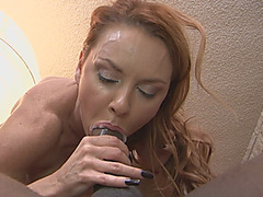 Redhead MILF with big tits is insatiable and takes on three black cocks