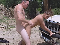 Sexy brunette got caught and fucked by the border patrol officer