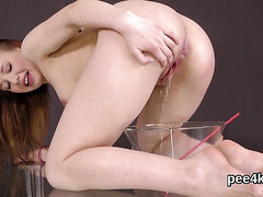 Exceptional nympho is pissing and pleasing smooth cunt