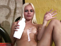 White cream is poured down this horny shemales tits and cock