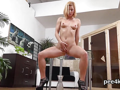 Stunning cutie is peeing and masturbating shaven cunt