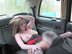 Blonde lady makes love inside the taxi with the fake taxi driver
