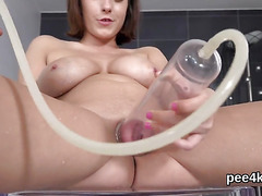 Attractive sweetie is pissing and pleasing shaven vagina