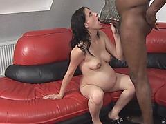 Pregnant slut bouncing on long black schlong