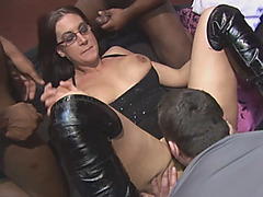 Busty slut Emma Butt gets serviced by many guys at the same time during gangbang