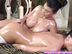 Bigtitted lesbian masseuse rubbing beauty