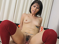 A sweet brunette Latin babe rides her lover's hard cock while he's filming her