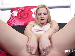 Perfect sweetie is peeing and pleasuring shaven vagina