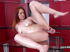 Exquisite nympho is peeing and rubbing shaven honey pot